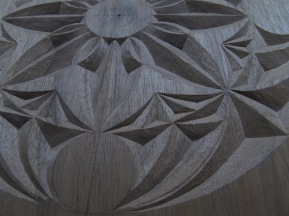 Wood carving: Chip carved rosette design , back of bellows project. Carved in European Walnut