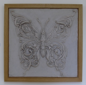 Modelling & Casting: Ornamental butterfly, based on Alex Konahin design: modelled in clay & cast in Marble dust & resin, with Oak frame